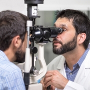 male-doctor-ophthalmologist-is-checking-eye-vision-handsome-young-man-modern-clinic_35